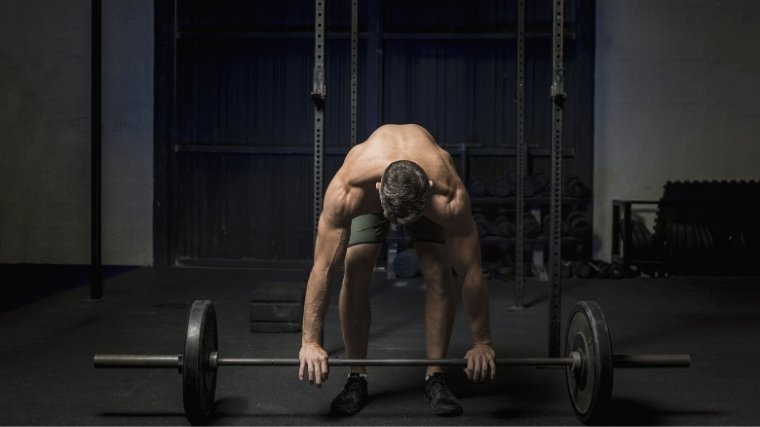 man setting up for barbell lift
