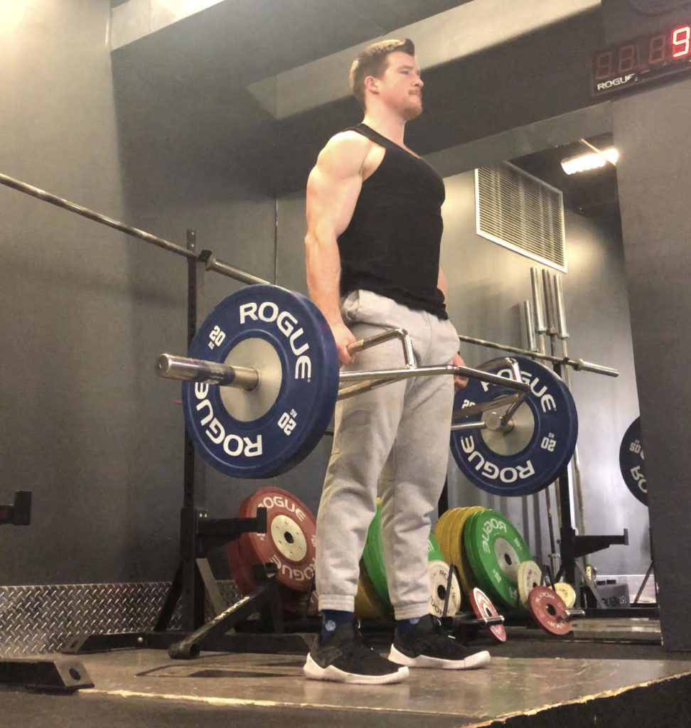 Trap Bar Deadlift Exercise Guide - Lockout