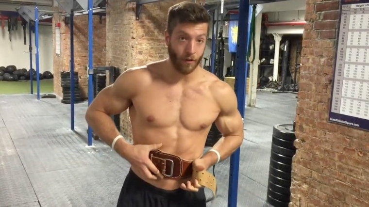 Man tightening weightlifting belt