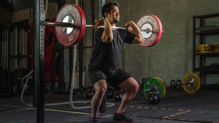 Man front-squatting