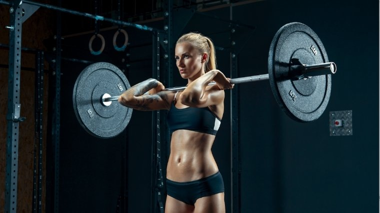 Woman at top of front squat