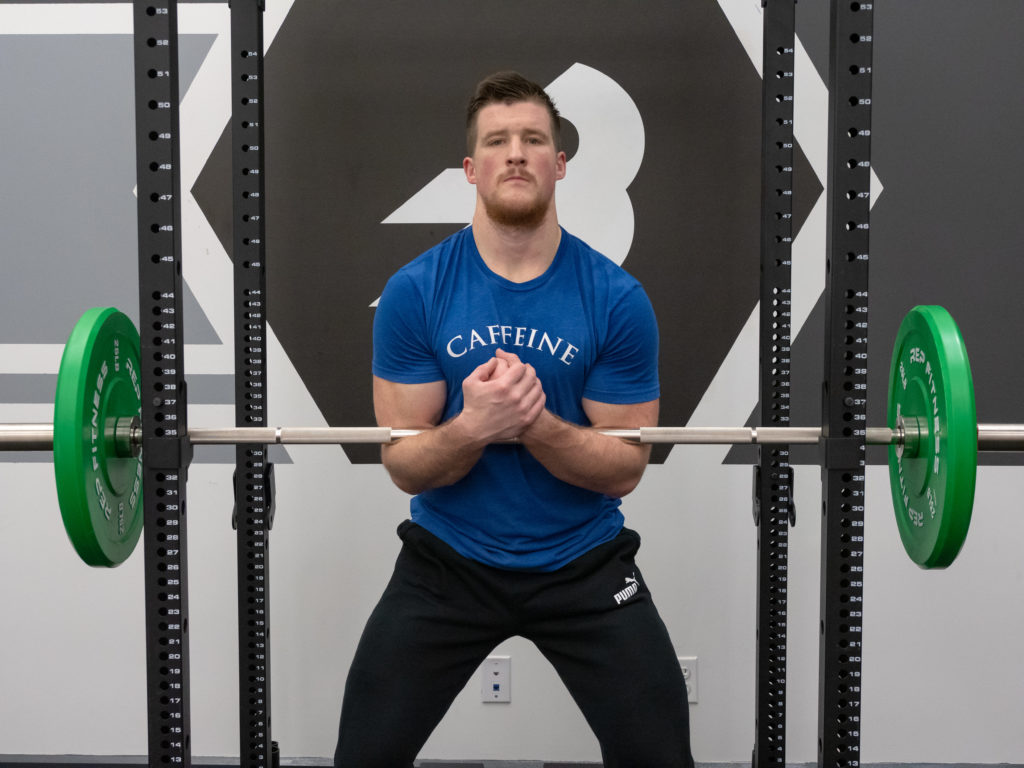 Zercher Squat Exercise Guide - Bar Positioning