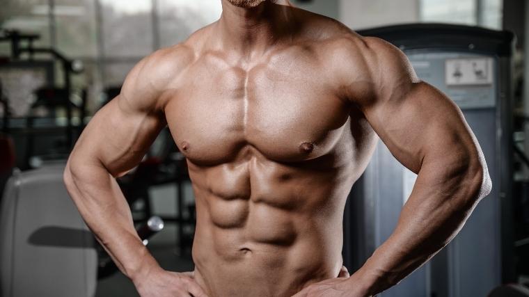 man flexing chest