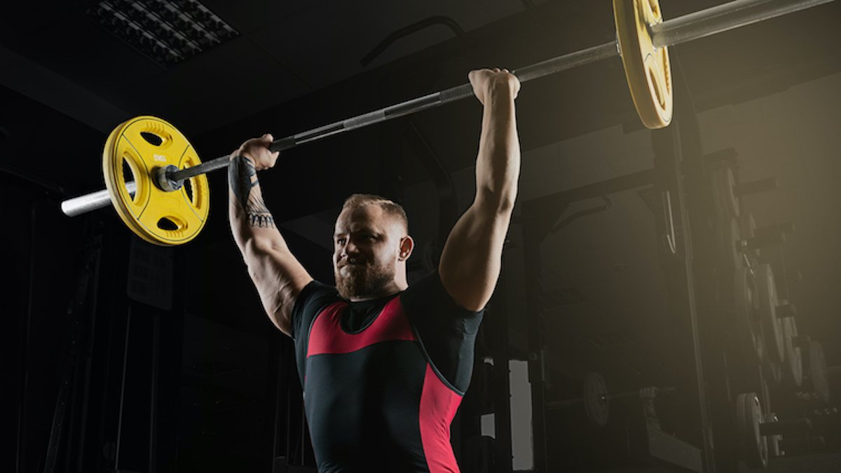 5 Benefits of the Overhead Press - BarBend