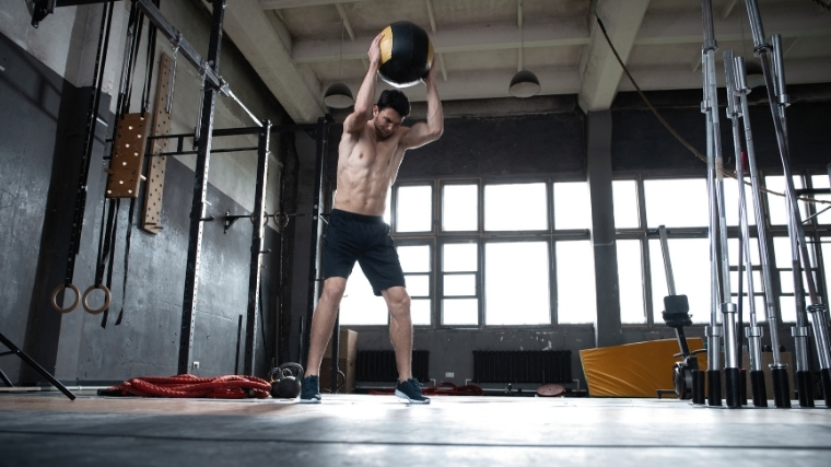 MAn slamming medicine ball