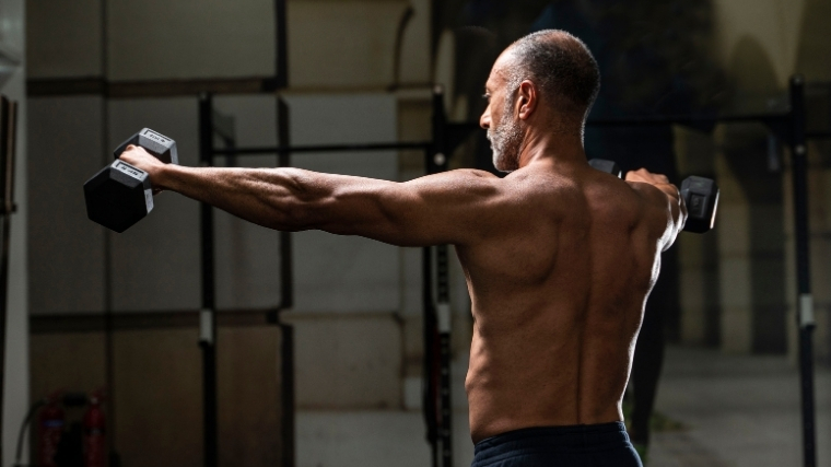 man performing lateral raises