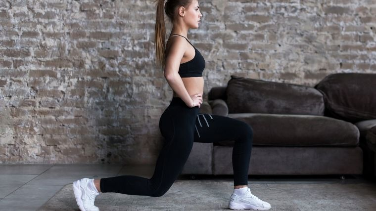 Woman performing forward lunge