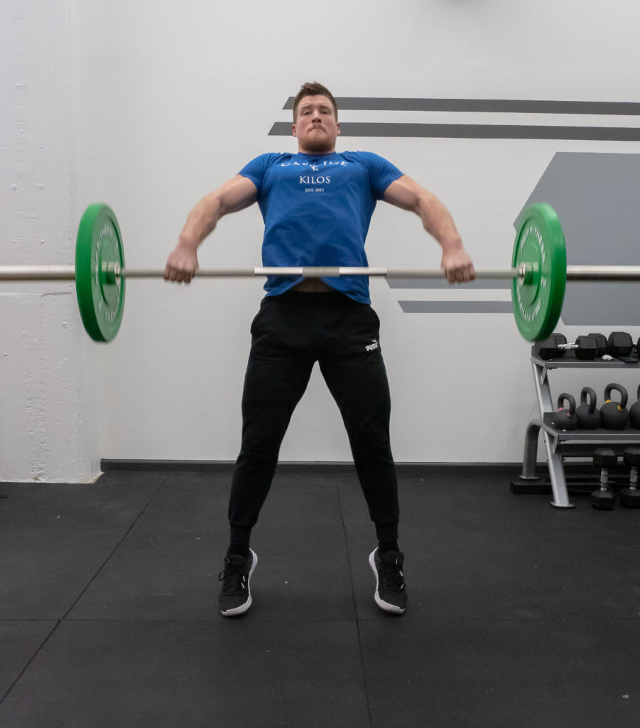 Hang Snatch Exercise Guide - Extend Up