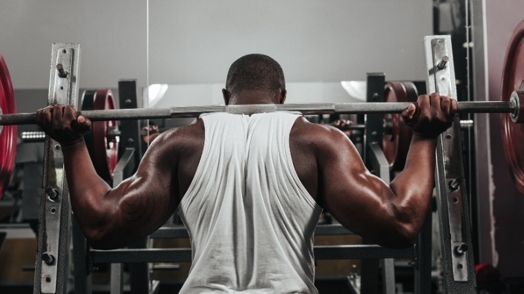 Man back squatting weight
