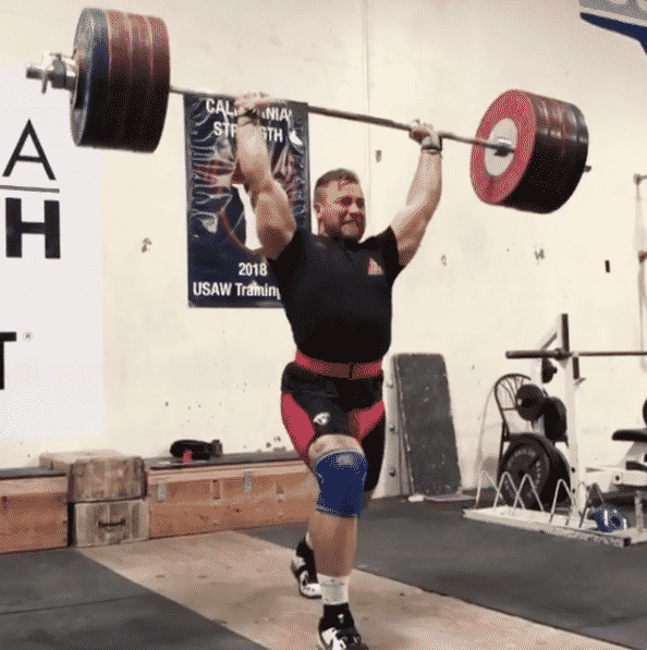 Wes Kitts barely misses a 221kg clean & jerk