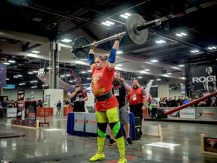 Female athlete overhead press