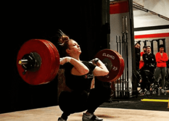 Weightlifter Sam Poeth executes a clean and jerk