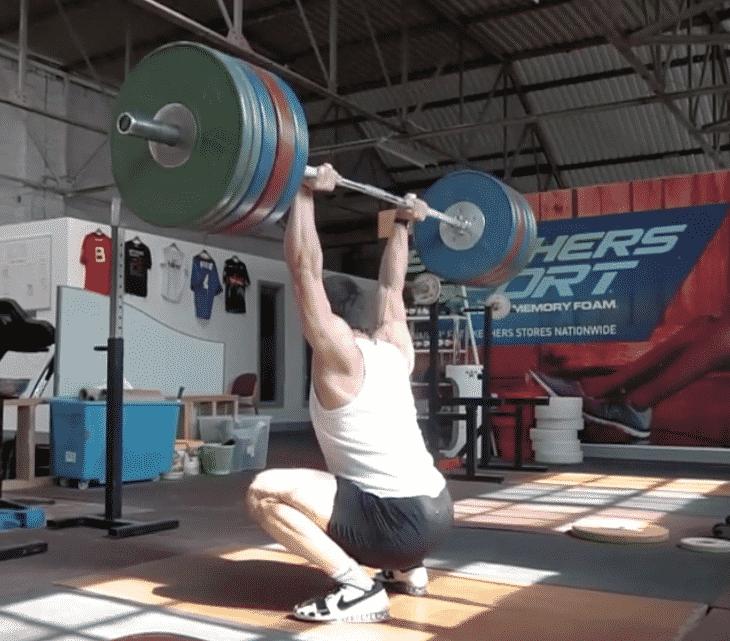 Watch Clarence Kennedy's Huge 190kg Squat Jerk - BarBend