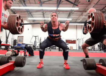 An athlete performing a back squat