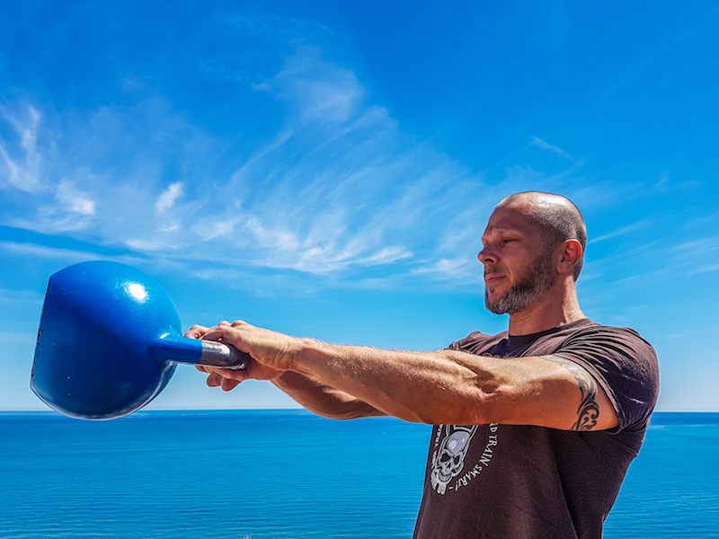 3 Ways to Build a Kettlebell Pyramid Workout - BarBend
