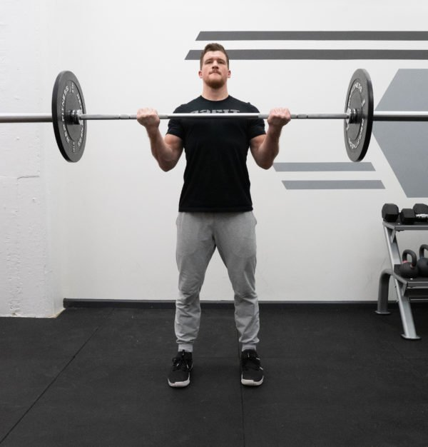 Barbell Curl Exercise Guide - Squeeze at the Top