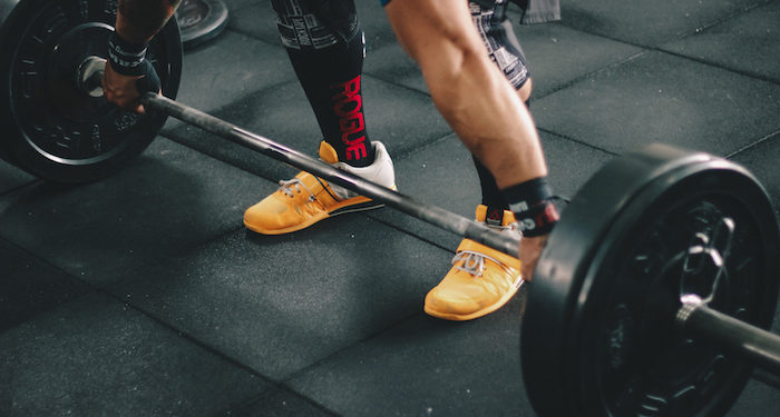 person about to lift barbell free