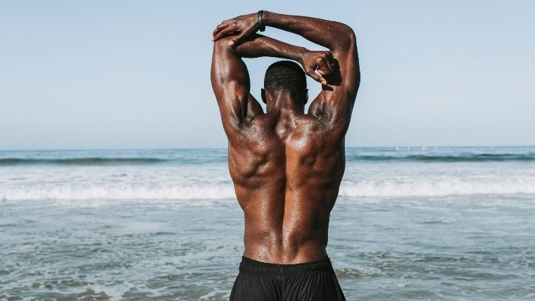 man with upper back muscles
