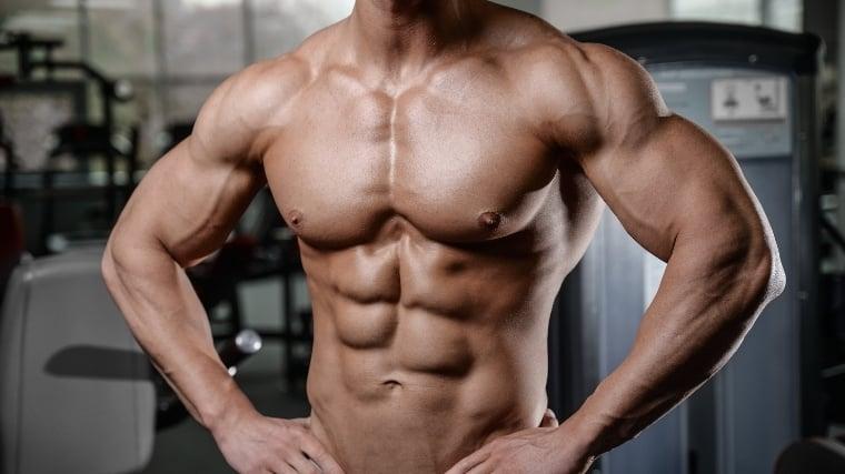 man flexing chest muscles