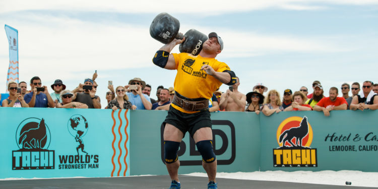 Athletes compete in overhead press in the 2019 42nd World's Strongest Man Competition on Coquina Beach in Bradenton, Fla., on Friday, June 14, 2019. /
