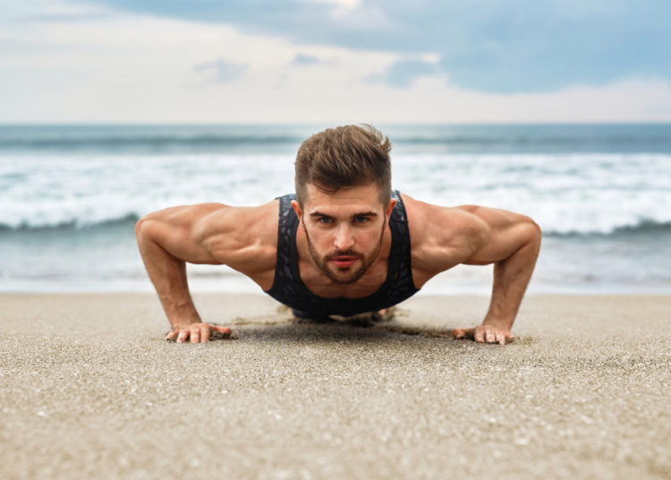 The Surprising Benefits of Doing Push-Ups In the Sand - BarBend