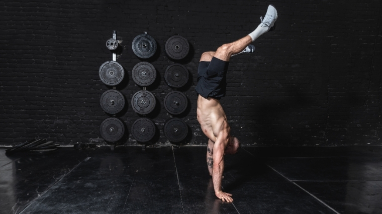 man doing handstand hold