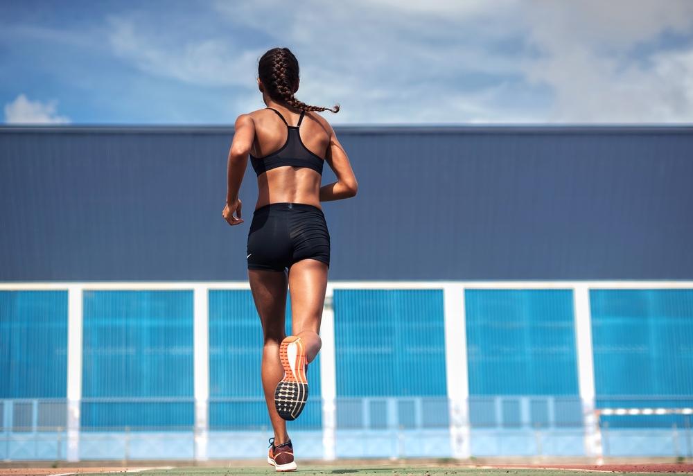 Woman Running in Sports Bra