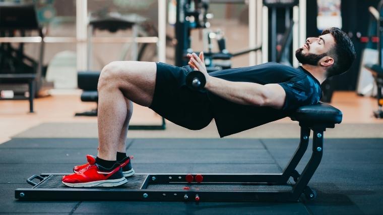 Man doing barbell hip thrust