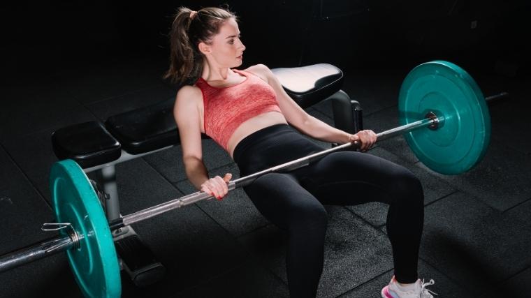 Woman doing barbell hip thrust