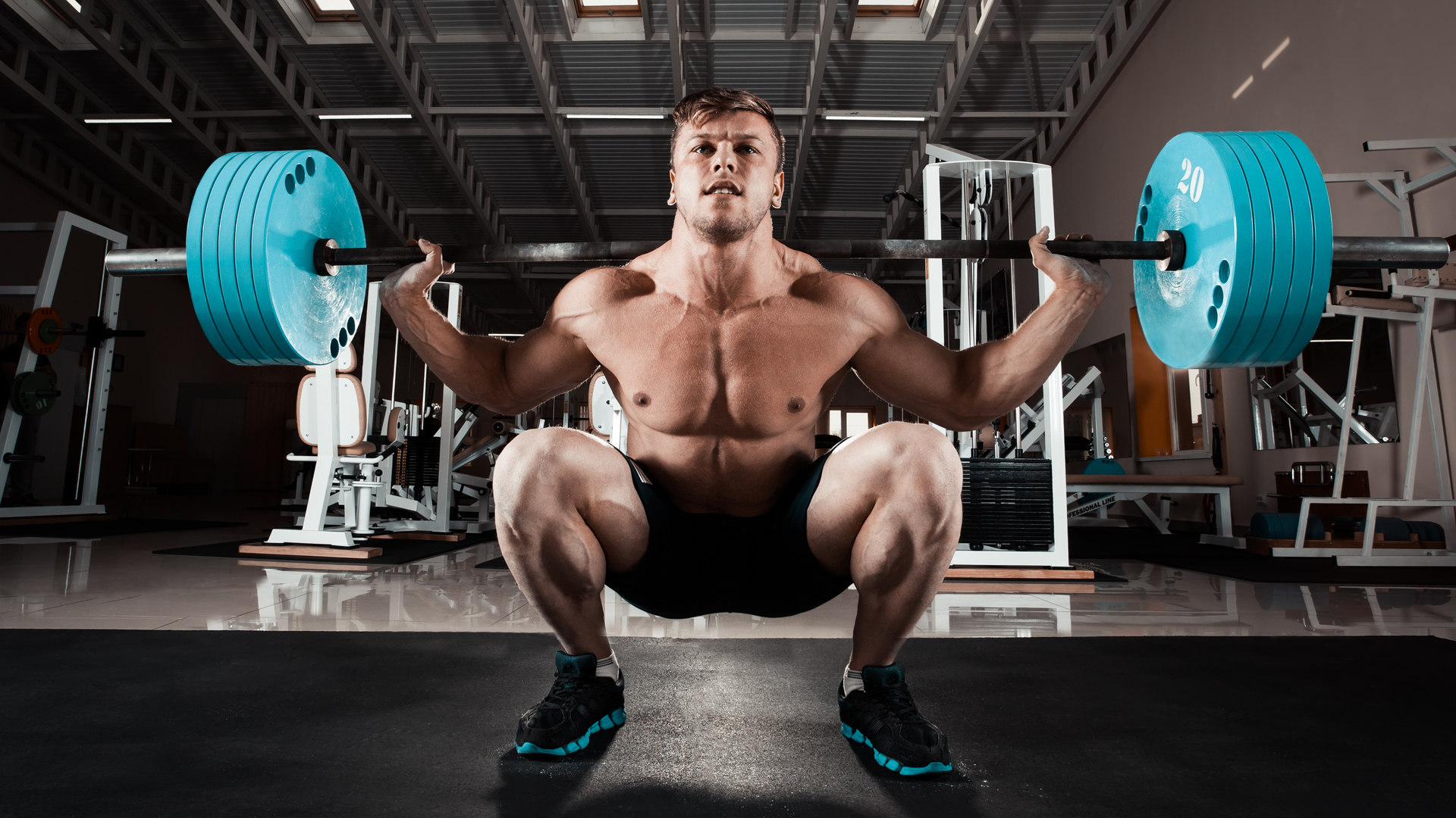 Athlete bracing his core during a squat