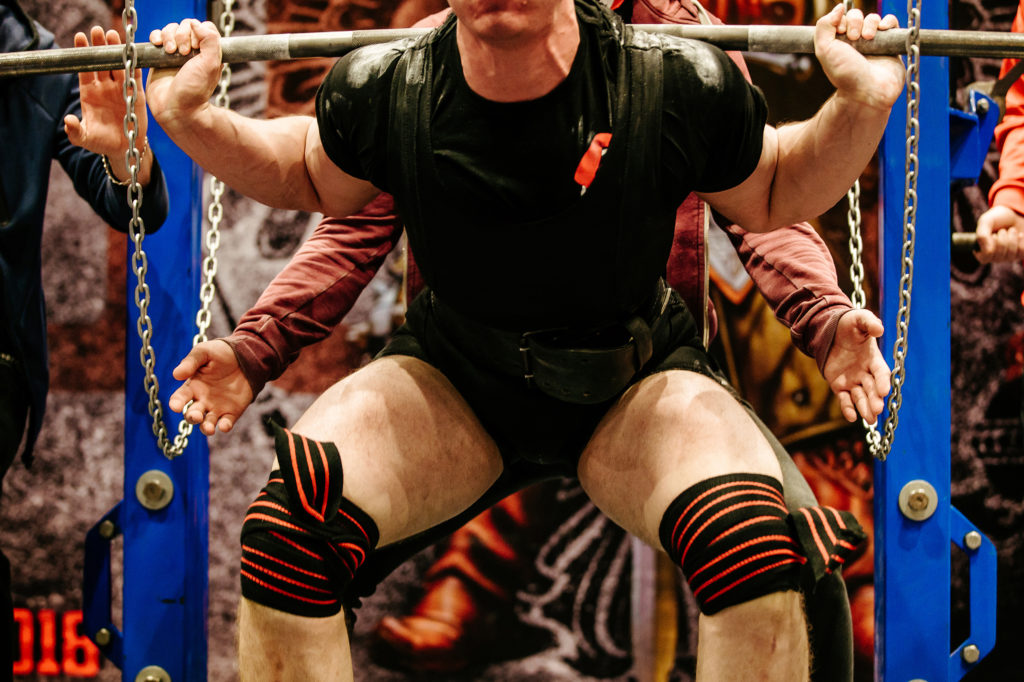 Powerlifter bracing his core during a squat