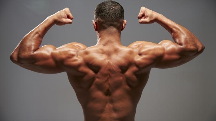 man flexing back muscles