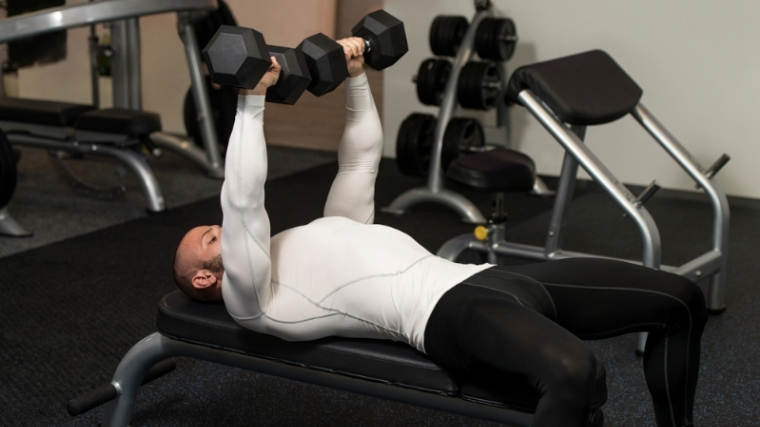 Man doing dumbbell chest press