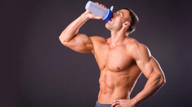 Man drinking from shaker bottle