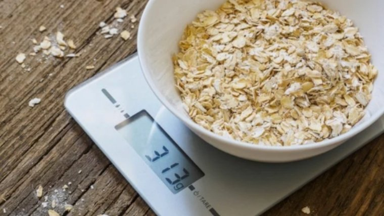 Oatmeal being weighed on food scale