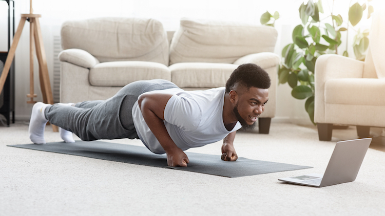 black man working out online at computer