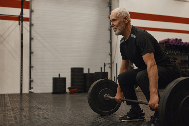 older guy with barbell