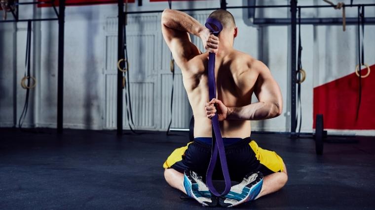 man stretching shoulders