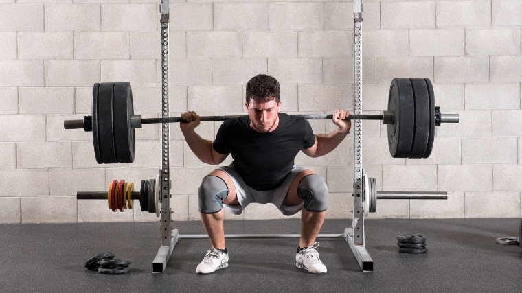 Man squatting a barbell