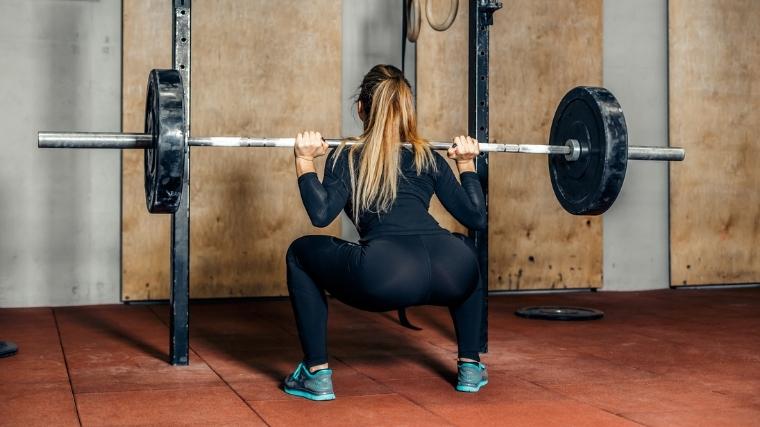 Woman squatting Barbell