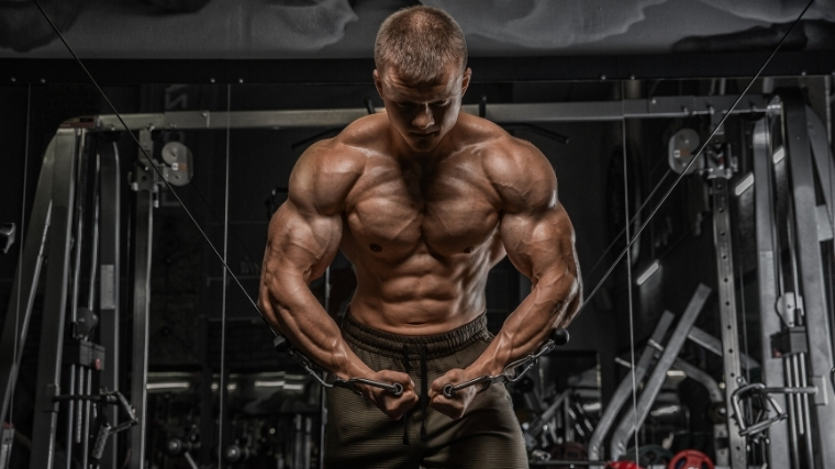 Bodybuilder doing chest flyes
