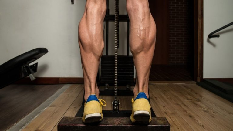 man doing standing calf raise