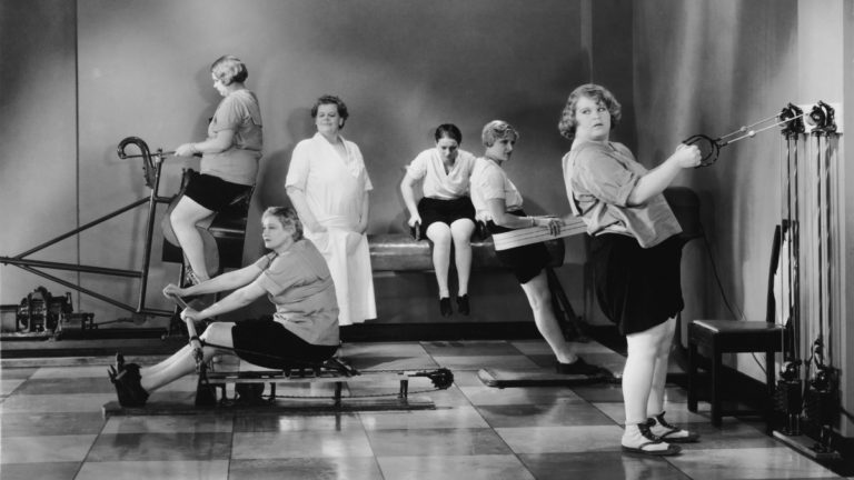 women training in vintage gym