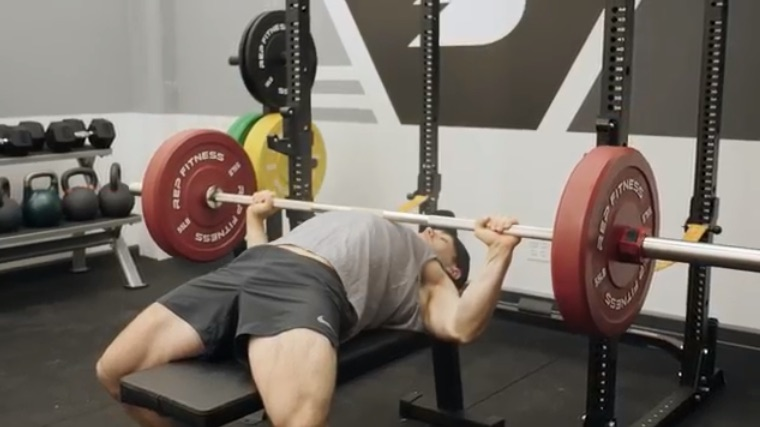 Pressing the barbell