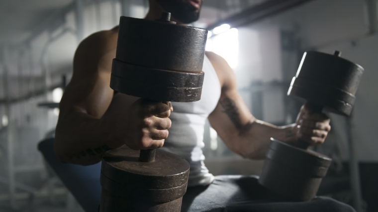 Man setting up for dumbbell bench press