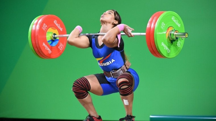 Woman weightlifter doing clean and jerk