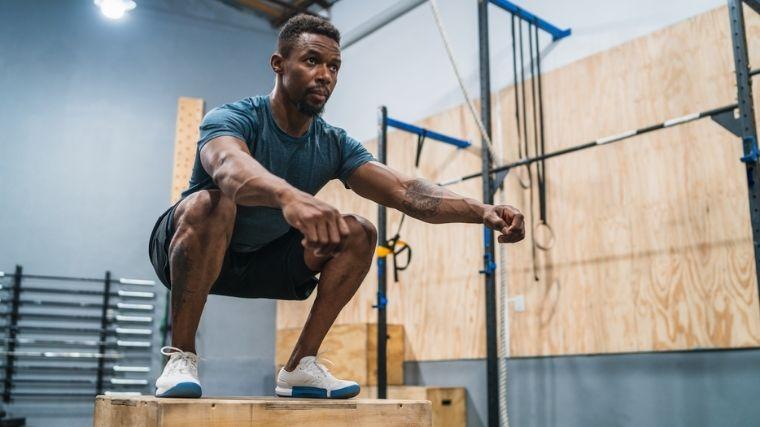 man performing box jump