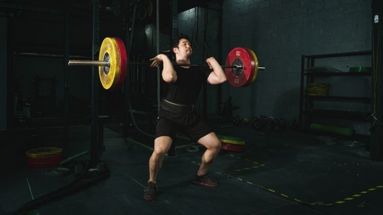 Man performing power cleans