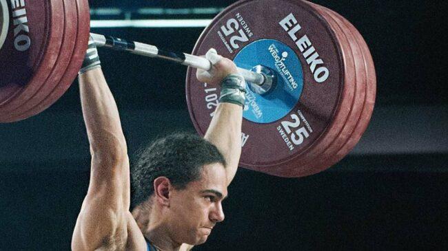 A lifter with an Eleiko barbell overhead