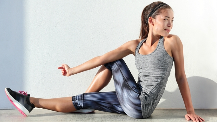 woman stretching her hips